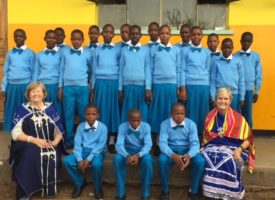 Karen Royce and Cheryl Kyle join the 23 Endupoto Primary School students who passed the Tanzania National Exam on their first day of class at Oljoro Tank Secondary School.