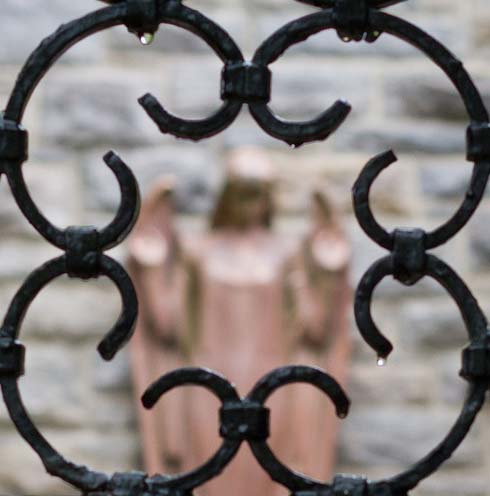 view of angel through the iron gate